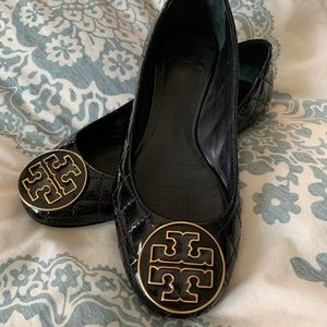 Quilted  black patent leather flats.
